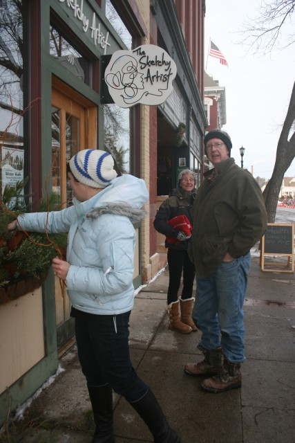 April Ripka, owner of The Sketchy Artist, Brett Norgaard (ice candle maestro), and Karin Norgaard at Winter Walk 2013