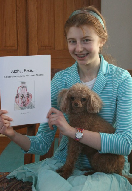 Author JJM Braulick with her newest publication and her usual poodle, Peanut.