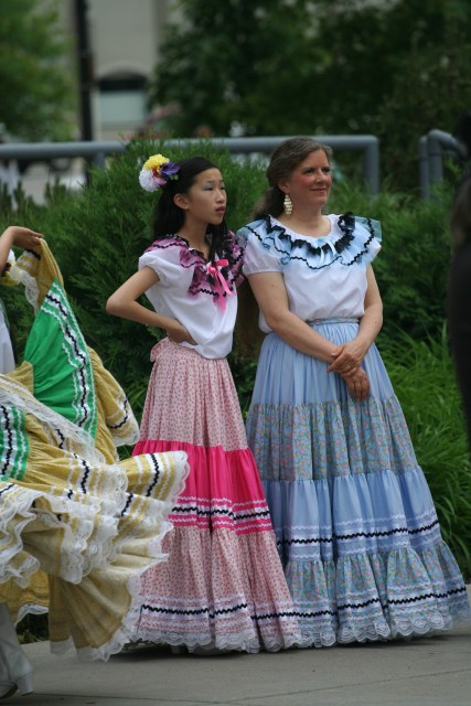 Atia with her mother, Kate Stuart, at Bridge Square, Northfield, in Sinaloa costumes